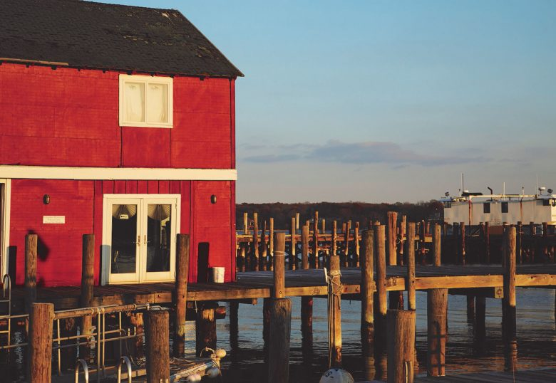 A red house between the piers on the water