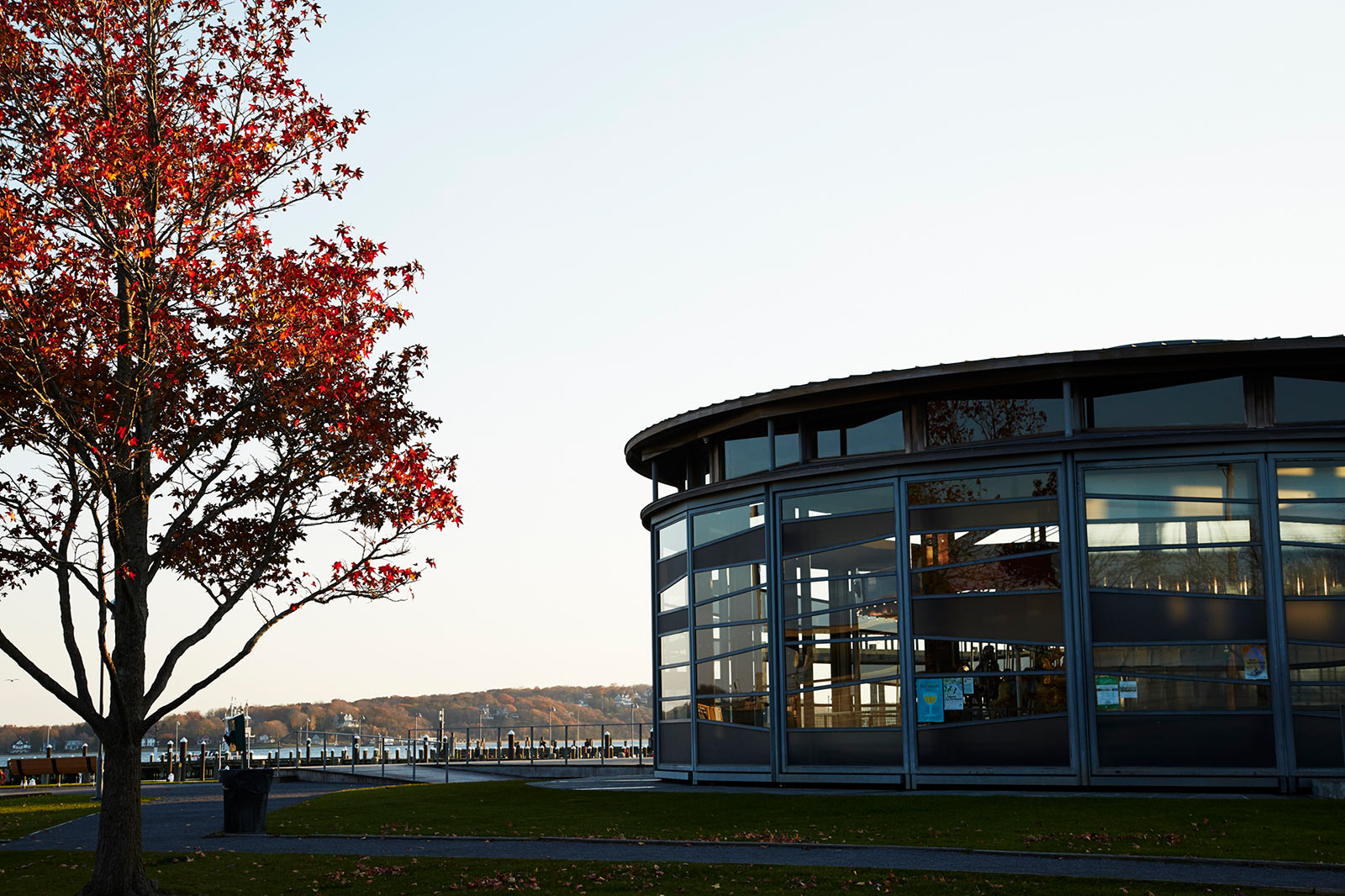 Exterior of a glass building with a view of the water
