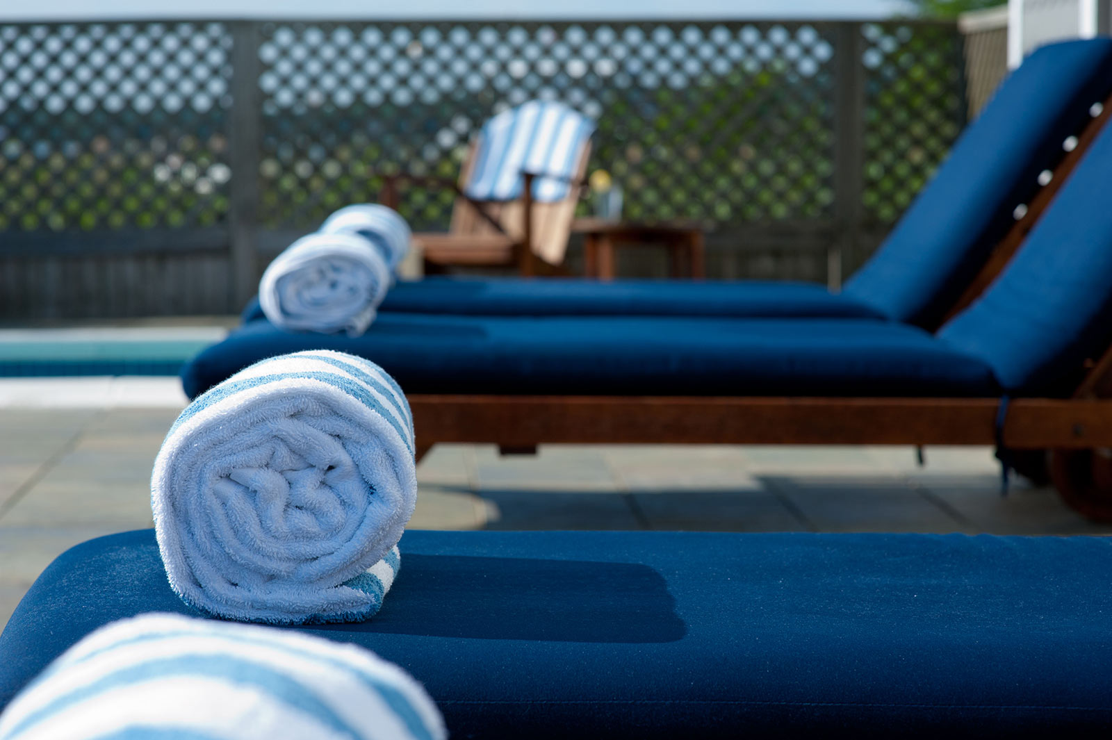 Close up of blue pool lounge chairs