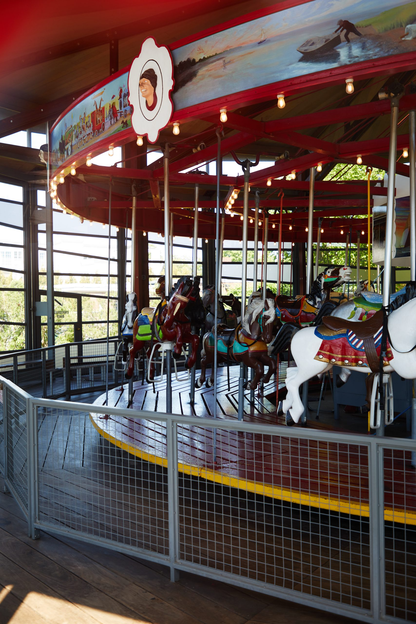 View of empty carousel from outside of fence