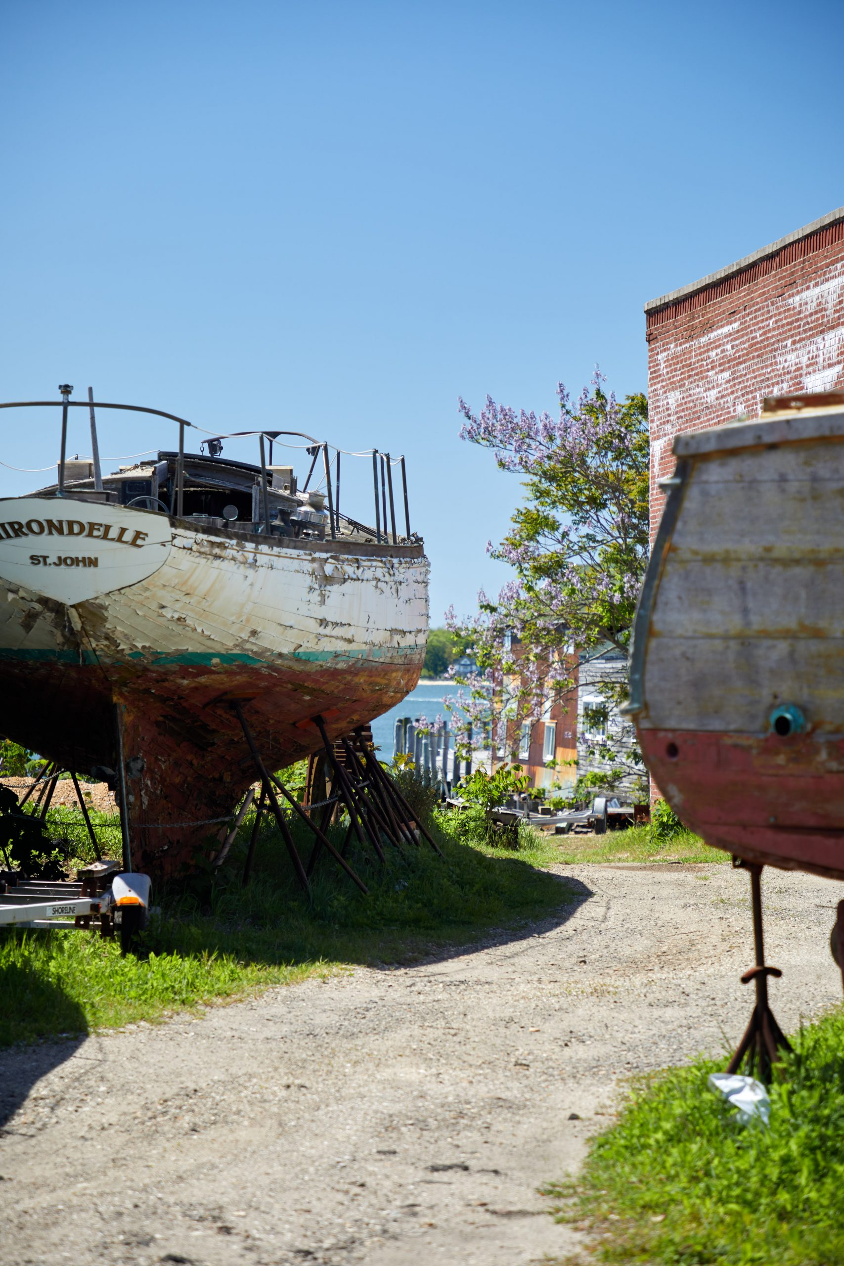 Old rusted ships sitting in the grass