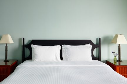 King size bed with two red nightstands on each side