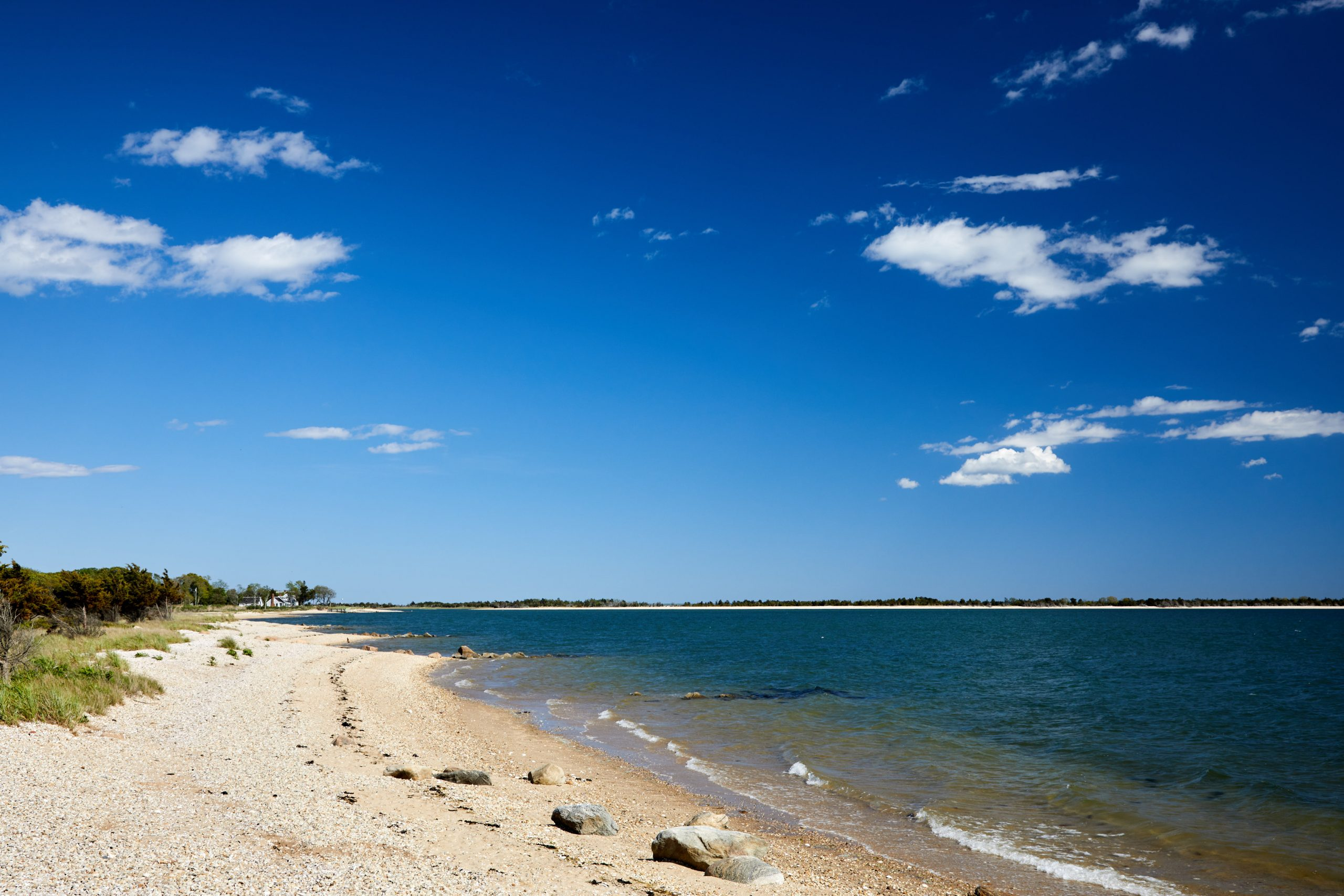 Clear beach shore with partial cloudy sky